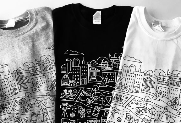 three tee shirts, gray, black, white, city skyline artwork