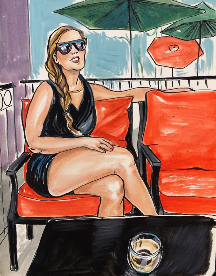 Woman sitting on an orange chair, wearing sunglasses